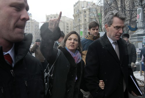 U.S. Assistant Secretary for European and Eurasian Affairs Victoria Nuland, center, gestures as she and U.S. Ambassador to Ukraine Geoffrey Pyatt, right, walk through the Independence Square in Kiev, Ukraine, Tuesday, Dec. 10, 2013. Top Western diplomats headed to Kiev Tuesday to try to defuse a standoff between President Viktor Yanukovych's government and thousands of demonstrators, following a night in which police in riot gear dismantled protesters' encampments outside government buildings. (AP Photo/Sergei Chuzavkov)