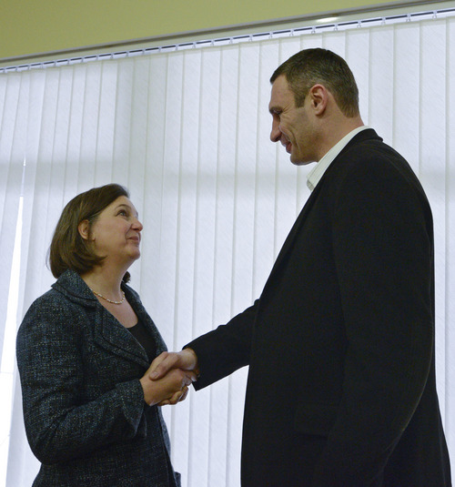U.S. Assistant Secretary for European and Eurasian Affairs Victoria Nuland, left, shakes hands with Ukrainian lawmaker and chairman of the opposition party Udar (Punch), WBC heavyweight boxing champion Vitali Klitschko in Kiev, Ukraine, Tuesday, Dec. 10, 2013. Top Western diplomats headed to Kiev Tuesday to try to defuse a stand-off between President Viktor Yanukovych's government and thousands of demonstrators, following a night in which police in riot gear dismantled protesters' encampments outside government buildings. (AP Photo/Andrew Kravchenko, Pool)