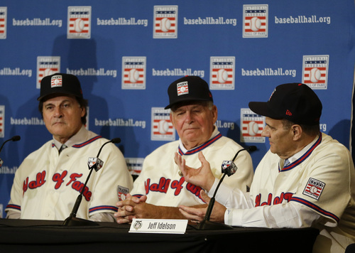 Joe Torre, far right, speaks at a news conference with Tony La Russa, left, and Bobby Cox after it was announced the retired managers were unanimously elected to the baseball Hall of Fame during the  MLB winter meetings in Lake Buena Vista, Fla., Monday, Dec. 9, 2013.(AP Photo/John Raoux)