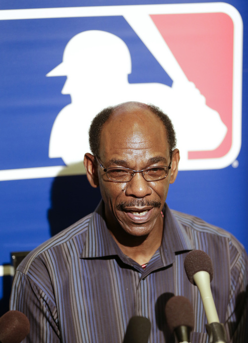 Ron Washington, manager of the Texas Rangers, meets with reporters during a news conference at the MLB winter meetings in Lake Buena Vista, Fla., Monday, Dec. 9, 2013.(AP Photo/John Raoux)