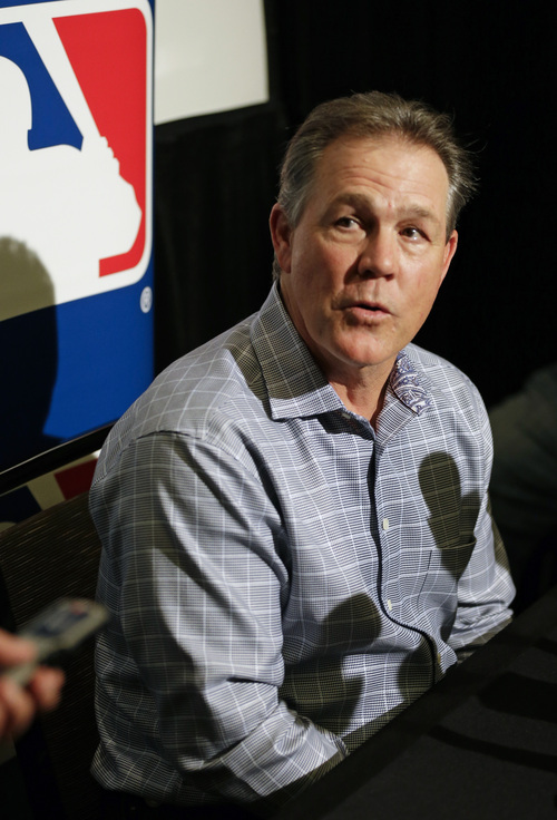 Ned Yost, manager of the Kansas City Royals, answers questions at a news conference at the MLB winter meetings in Lake Buena Vista, Fla., Monday, Dec. 9, 2013. (AP Photo/John Raoux)