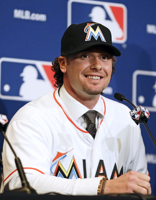 Jarrod Saltalamacchia of the Miami Marlins answers questions during a news conference at the MLB winter meetings in Lake Buena Vista, Fla., Monday, Dec. 9, 2013. Saltalamacchia signed a three-year deal with the Marlins. (AP Photo/John Raoux)