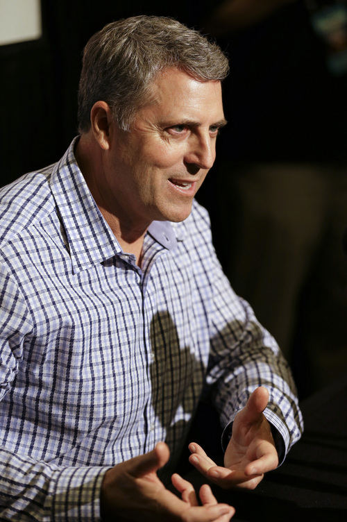 Bryan Price, manager of the Cincinnati Reds, talks with reporters during a media availability at MLB winter meetings in Lake Buena Vista, Fla., Monday, Dec. 9, 2013.(AP Photo/John Raoux)