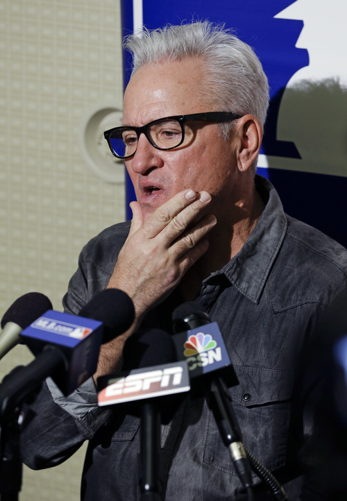 Joe Madden, manager for the Tampa Bay Rays speaks with reporters at the MLB winter meetings in Lake Buena Vista, Fla., Monday, Dec. 9, 2013.(AP Photo/John Raoux)