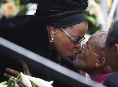 Winnie Madikizela-Mandela, Nelson Mandela's former wife, kisses Retired Anglican Archbishop Desmond Tutu during the memorial service for former South African president Nelson Mandela at the FNB Stadium in Soweto near Johannesburg, Tuesday, Dec. 10, 2013. (AP Photo/Matt Dunham)