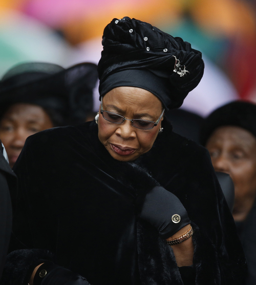 Nelson Mandela's widow Graca Machel lowers her head as she listens to speakers during the memorial service for former South African president Nelson Mandela at the FNB Stadium in Soweto near Johannesburg, Tuesday, Dec. 10, 2013. (AP Photo/Matt Dunham)