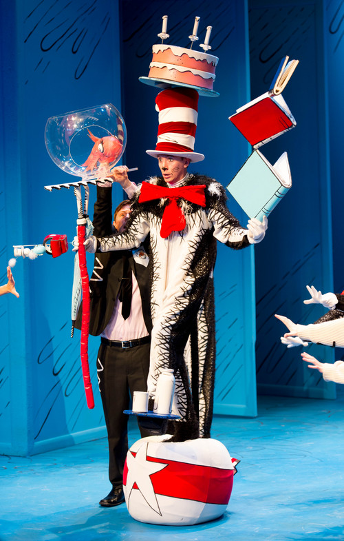 "Trent Nelson  |  The Salt Lake Tribune The Cat, Austin Archer, balancing in Salt Lake Acting Company's ""The Cat in the Hat"" Tuesday December 10, 2013 in Salt Lake City."