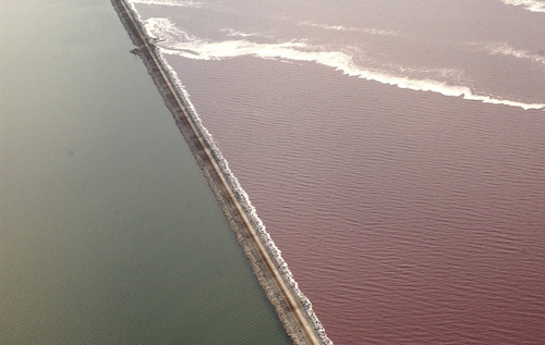 The Union Pacific causeway across the Great Salt Lake separates the super-saline North Arm (right) from the rest of the lake. The last culvert that allows the water to mix could collapse any day, prompting regulators to grant emergency permission to fill it.    Francisco Kjolseth/The Salt Lake Tribune      08/27/2002