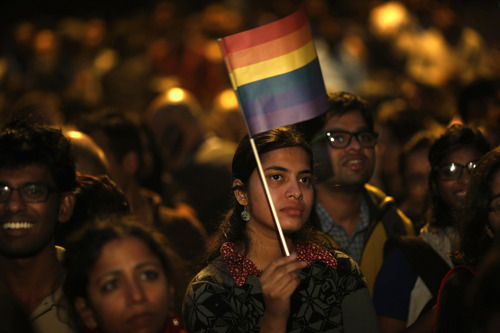 Gay rights activists attend a protest meeting after the top Indian court ruled that a colonial-era law criminalizing homosexuality will remain in effect in India in New Delhi, India, Wednesday, Dec. 11, 2013. The Supreme Court threw out a 2009 New Delhi High Court decision that struck down the law as unconstitutional, dealing a blow to gay activists who have argued for years for the chance to live openly in India's deeply conservative society. The top court said it was for lawmakers and not the courts to decide the matter.  (AP Photo/Saurabh Das)