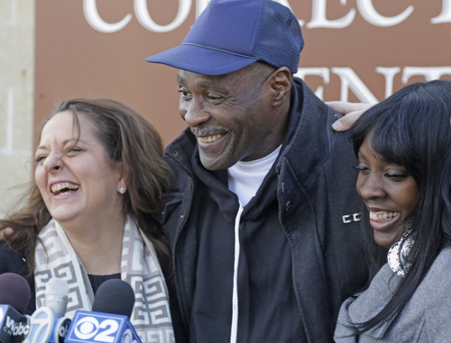 Stanley Wrice, center, convicted of rape and sentenced to 100 years in prison in 1982, speaks to the media with his lawyer Heidi Linn Lambros , left, and his daughter, Gail Lewis, as he leaves Pontiac Correctional Center Wednesday, Dec. 11, 2013 in Pontiac, Ill. Wrice was released after serving more than 30 years in prison when a Cook County Judge overturned his conviction the day before and granted him a new trial. Wrice has claimed for decades he was beaten and coerced into confessing to the rape by Chicago police Area 2 detectives working for disgraced former Chicago police Lt. Jon Burge. Burge himself, is now in federal prison after being convicted of perjury related to torture allegations. Judge Richard Walsh's ruling comes after the officers working for Lt. Burge  who Wrice says beat him, invoked their right not to testify. (AP Photos/M. Spencer Green)