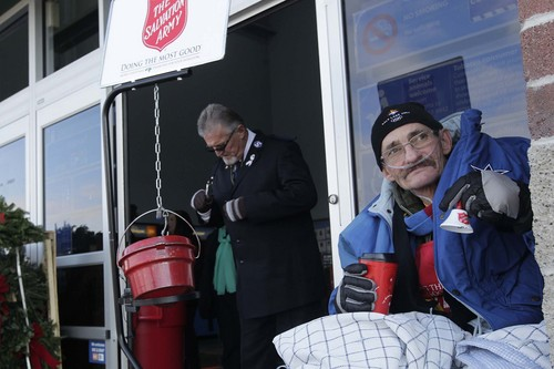 Leah Hogsten  |   The Salt Lake Tribune Former Ogden Salvation Army employee Douglas Holladay rings the bell December 5, 2013, at the Riverdale Wal-Mart to fill three three red kettles with money for the needy. Holladay has terminal lung cancer and has been told by doctors that he may not live until Christmas, so he told the Salvation Army that he wanted to collect donations one final time.