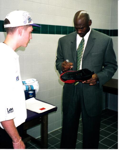 d2e1e44b13b0 Courtesy of Preston Truman Michael Jordan signs his