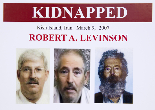 An FBI poster showing a composite image of retired FBI agent Robert Levinson, right, of how he would look like now after five years in captivity, and an image, center, taken from the video, released by his kidnappers, and a picture before he was kidnapped, left, displayed during a news conference in Washington, on March 6, 2012. The FBI announced a reward of up to $1,000,000 for information leading to the safe location, recovery and return of  Levinson, who disappeared from Kish Island, Iran, five years ago on March 9, 2007. For years the U.S. has publicly described him as a private citizen who was traveling on private business. However, an Associated Press investigation reveals that Levinson was working for the CIA. There has been no hint of Levinson's whereabouts since his family received proof-of-life photos and a video in late 2010 and early 2011. (AP Photo/Manuel Balce Ceneta)