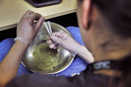 In this Dec. 6, 2013 photo, an employee of The Clinic, a Denver-based dispensary with several outlets, prepares marijuana joints to be sold, in Denver. The Clinic is among the roughly 150 medical marijuana dispensaries hoping to begin selling to recreational users when it becomes legal to sell on Jan. 1, 2014. The state's hopeful pot shops are so mired in red tape and confusion that no one knows yet when or if they'll be allowed to open. Not a single shop will clear state and local licensing requirements until about Dec. 27. (AP Photo/Brennan Linsley)(AP Photo/Brennan Linsley)