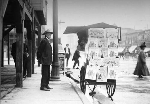 A gentleman stands next to a news stand in Salt Lake City, circa 1901. Courtesy Utah State Historical Society