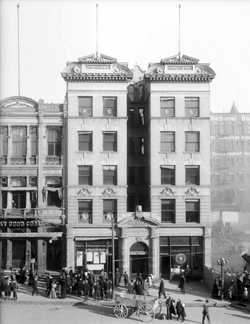 Photo Courtesy Utah State Historical Society  Herald-Republican Newspaper in the Herald Building (erected 1905), adjacent buildings, and the Walker Bank Building construction project on Main Street in 1911.