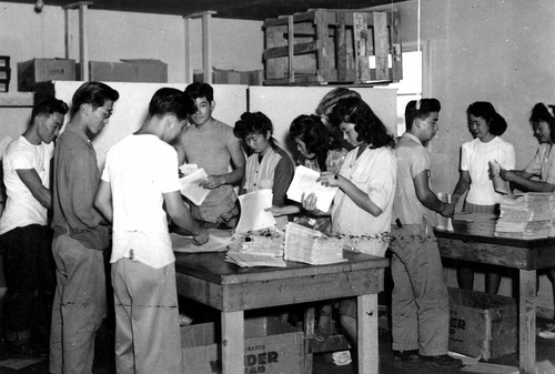 Photo Courtesy Utah State Historical Society  Topaz Times newspaper circulation workers, circa 1943.