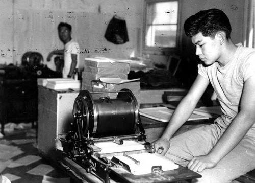 Photo Courtesy Utah State Historical Society  Topaz Times newspaper press workers, circa 1943.