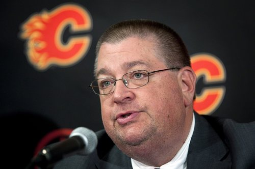 FILe - In this May 31, 2012 file photo, Calgary Flames' general manager Jay Feaster answers questions during a news conference in Calgary, Alberta. Feaster has been fired as general manager of the Calgary Flames, with the team in next-to-last place in the Western Conference. Assistant GM John Weisbrod also was let go Thursday, Dec. 12, 2013. There is no immediate word on successors to Feaster or Weisbrod. (AP Photo/The Canadian Press, Jeff McIntosh)