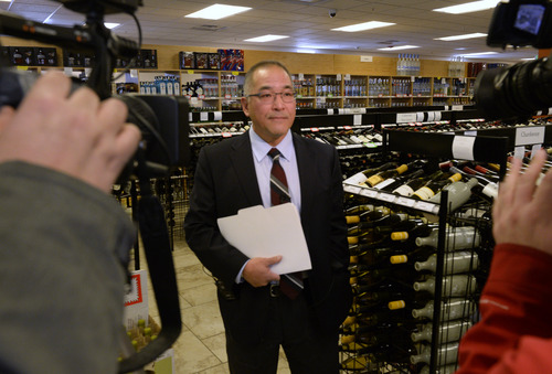 Rick Egan   |  The Salt Lake Tribune  Doug Murakami, alcohol education director, talks about what the state is doing to remind parents to keep their underage children away from alcohol, during a media event Thursday, Dec. 12, 2013. The state is posting signs, posters and bottleneck hangers in liquor stores to remind parents to keep their underage children away from alcohol.