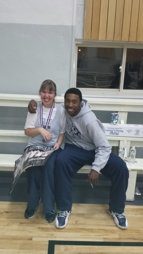 Courtesy Erica Lundahl Freshman Utah State guard JoJo McGlaston takes a picture with Tia Maughan, a participant in Top Sports. Several Aggies took time Dec. 11 to assist the program, which allows kids with disabilities to participate in athletics.