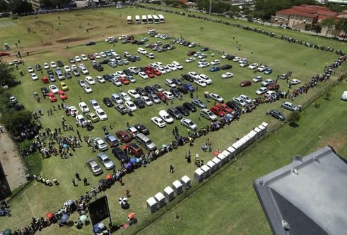 People queue to catch a bus to see the body of Nelson Mandela at the Union Buildings in Pretoria, South Africa, Friday Dec. 13, 2013, where his body lies in state for the third day of three days of public viewing. (AP Photo/Themba Hadebe)