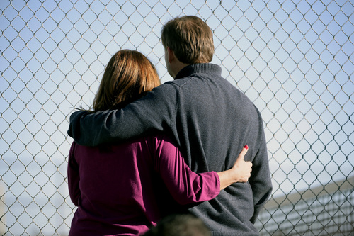 Parents stand along the tennis court fence hoping to see if their child is standing outside on the football field after a gunman was spotted inside Arapahoe High School on Friday, Dec. 13, 2013, in Centennial, Colo. Authorities said the gunman shot two students and then turned the gun on himself. The shooting came a day before the anniversary of the Newtown, Conn., attack in which a gunman killed 20 children and six adults at Sandy Hook Elementary School. (AP Photo/The Denver Post, John Leyba) MAGS OUT; TV OUT; INTERNET OUT; NO SALES; NEW YORK POST OUT; NEW YORK DAILY NEWS OUT