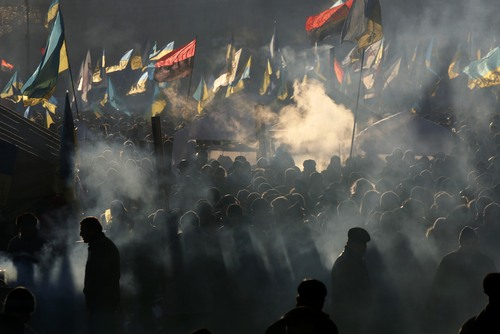 Pro-European Union activists gather during a rally in Independence Square in Kiev, Ukraine, Saturday, Dec. 14, 2013. The opposition has called for a vast turnout Sunday. Rallies on the previous two Sundays drew hundreds of thousands of protesters. That same day, Yanukovych's Party of Regions has called for a pro-government demonstration that it claims will bring 200,000 people to Kiev. (AP Photo/Dmitry Lovetsky)