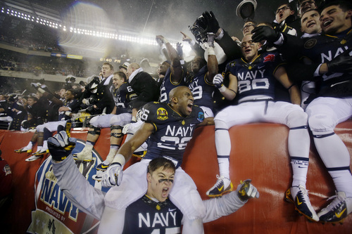 Navy celebrates after an NCAA college football game against Army, Saturday, Dec. 14, 2013, in Philadelphia. Navy won 34-7. (AP Photo/Matt Slocum)