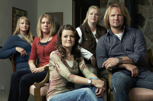 "Kody Brown, right, with ""sister wives"" Christine, left, Meri, Robyn and Janelle.  Joe Pugliese 