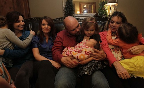 "Leah Hogsten  |  The Salt Lake Tribune Polygamist Joe Darger and his wives, from left, Alina, Valerie and Vicki watch as daughter Krista, 4, holds 3-day-old sister Alexandra Tess, the newest member of the family, while Victoria, 3, kisses Vicki. The Darger's celebrated the ruling handed down by U.S. District Court judge Clark Waddoups that key parts of Utah's polygamy laws are unconstitutional, Dec. 13, 2013. ""For the first time in my lifetime -- and in the last 100 years, we don't have a cloud over our heads,"" said Joe of the ruling. ""This is historic."""