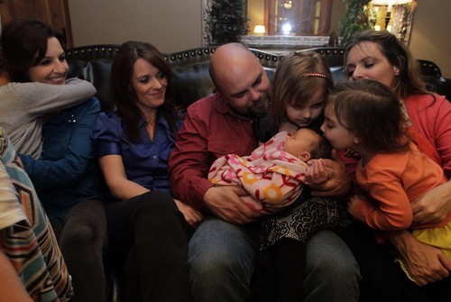 "Leah Hogsten  |  The Salt Lake Tribune Polygamist Joe Darger and his wives, from left,  Alina, Valerie and Vicki watch as daughters Krista, 4, and Victoria, 3, kiss their 3-day-old sister Alexandra Tess, the newest member of the family. The Darger's celebrated the ruling handed down by U.S. District Court judge Clark Waddoups that key parts of Utah's polygamy laws are unconstitutional, December 13, 2013. ""For the first time in my lifetime--and in the last 100 years, we don't have a cloud over our heads,"" said Joe of the ruling. ""This is historic."""