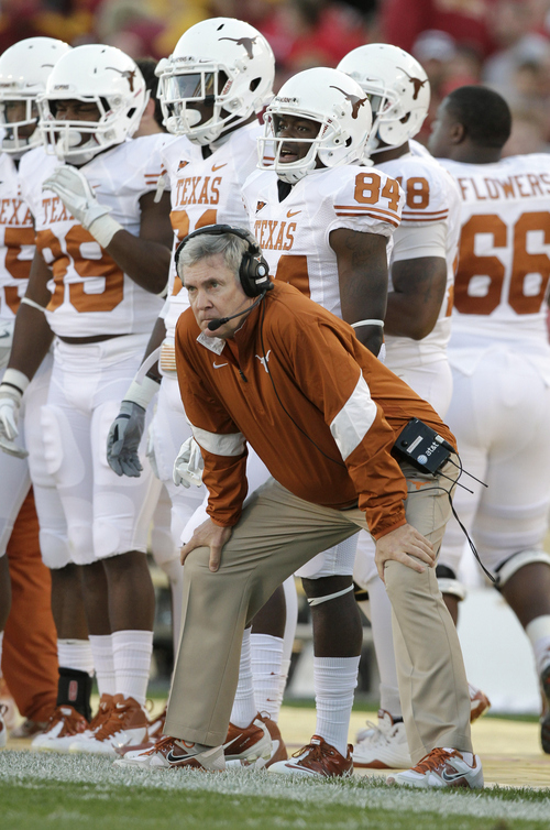 Texas head coach Mack Brown stands on the sidelines during an NCAA college football game against Iowa State, Saturday, Oct. 1, 2011, in Ames, Iowa. (AP Photo/Charlie Neibergall)