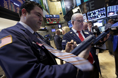 Traders work on the floor of the New York Stock Exchange Monday, Dec. 16, 2013. U.S. stocks rose sharply on Monday, powered by two big corporate deals and news that suggests the economy is getting stronger. (AP Photo/Richard Drew)