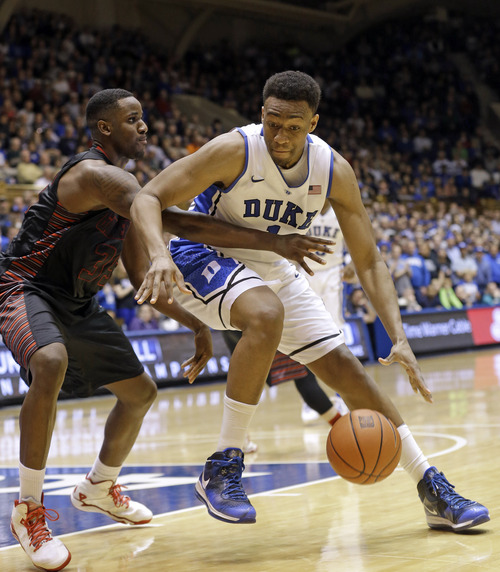 Gerry Broome | The Associated Press Duke's Jabari Parker, right, is guarded by Gardner-Webb's Jerome Hill (35) during the second half of an NCAA college basketball game in Durham, N.C., Monday, Dec. 16, 2013. Duke won 85-66. (AP Photo/Gerry Broome)