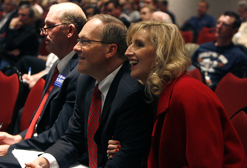 Robert Smith, center with his wife Kristine on his arm react to the announcement that he was chose as one of the three candidates to be sent on to Utah Gary Herbert to choose  to replace former attorney general John Swallow. After five ballots they selected: Sean Reyes, Robert Smith, and finally Brian Tarbet.  (AP Photo/ The Salt Lake Tribune, Scott Sommerdorf)