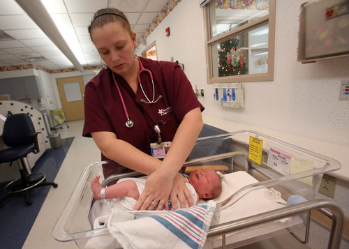 "Francisco Kjolseth  |  The Salt Lake Tribune St. Mark's Labor and Delivery RN Amanda Pulliam wraps Mackenzie Glauser, less than two days old, so one foot is exposed to get a blood sample from her heel. Virtually every baby born in Utah undergoes a ""heel prick"" test, or newborn screening for over 30 diseases. The diseases are treatable but can be disabling and deadly if not promptly diagnosed. But many hospitals take 5 days or more to deliver samples to the state lab ñ too long, according to informal standards embraced by most public health authorities. St. Mark's Hospital is among those that have made a concerted effort to expedite tests."