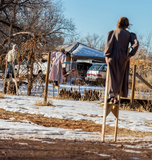 Trent Nelson  |  The Salt Lake Tribune Children rise above the mud and snow with stilts in Colorado City Saturday December 14, 2013.