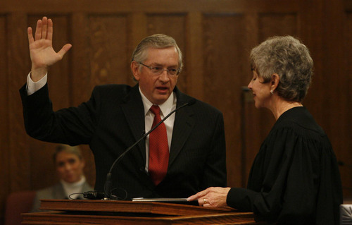 Utah Attorney Clark Waddoups (left) is sworn into the U.S. District Court by Chief Judge Tena Campbell. Utah Attorney Clark Waddoups was sworn in as Utah's 15th U.S. District judge at the Frank Moss US Courthouse Thursday. Waddoups was appointed to the bench on Oct. 21, 2008 by President George Bush.   Photo by Leah Hogsten/ The Salt Lake Tribune [city} 11/6/08