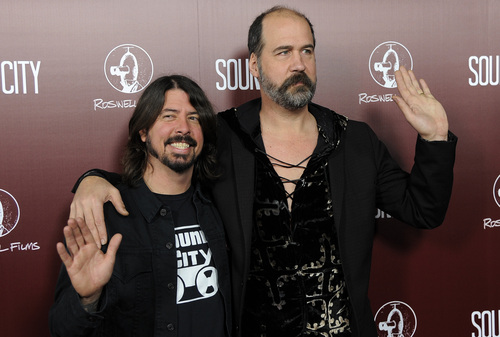 "FILE - In this Jan. 31, 2013 file photo, Dave Grohl, left, poses with Nirvana bandmate Krist Novoselic at the premiere of the documentary film ""Sound City,"" in Los Angeles. Nirvana will be inducted into the 2014 Rock and Roll Hall of Fame on April 10 at the Barclays Center in New York. (Photo by Chris Pizzello/Invision/AP, File)"