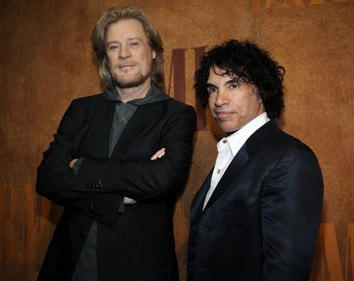 FILE - In this May 20, 2008 file photo, Daryl Hall, left, and John Oates pose before the 56th annual BMI Pop Awards in Beverly Hills, Calif. Hall and Oates will be inducted into the 2014 Rock and Roll Hall of Fame on April 10 at the Barclays Center in New York. (AP Photo/Chris Pizzello, File)