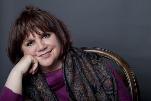 "FILE - In this Sept. 17, 2013 file photo, American musician Linda Ronstadt poses in New York to promote the release of her memoir ""Simple Dreams."" Ronstadt will be inducted into the 2014 Rock and Roll Hall of Fame on April 10 at the Barclays Center in New York. (Photo by Amy Sussman/Invision/AP, File)"
