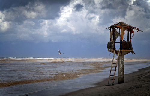 Dark clouds loom over the coast of the Mediterranean Sea in Gaza City, Friday, Dec. 13, 2013. Early snow has surprised many Israelis and Palestinians as a blustery storm, dubbed Alexa, brought gusty winds, torrential rains and heavy snowfall to parts of the Middle East. (AP Photo/Khalil Hamra)
