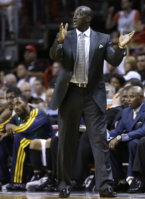 Utah Jazz head coach Tyrone Corbin gestures in the first half of an NBA basketball game against the Miami Heat, Monday, Dec. 16, 2013, in Miami. The Heat defeated the Jazz 117-94. (AP Photo/Lynne Sladky)