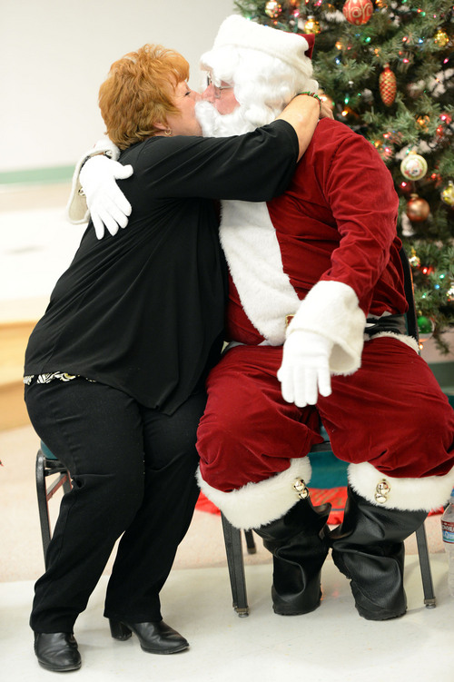 Francisco Kjolseth  |  The Salt Lake Tribune Mollie Brewer plants a kiss on Santa, long time family friend Danny Huffaker, during a lunch for seniors at the Salt Lake County senior center in Kearns on Tuesday, Dec. 17, 2013. The event is part of a Salt Lake County division of Aging Services holiday tradition to give back to our seniors who have helped build our communities and remain active members today.