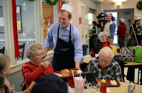 Francisco Kjolseth  |  The Salt Lake Tribune Salt Lake County Mayor Ben McAdams dons an apron to serve meals to seniors at the Salt Lake County senior center in Kearns on Tuesday, Dec. 17, 2013. The event is part of a Salt Lake County division of Aging Services holiday tradition to give back to our seniors who have helped build our communities and remain active members today.