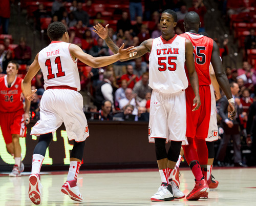 Trent Nelson  |  The Salt Lake Tribune Utah's Brandon Taylor (11) high-fives Utah's Delon Wright (55) during a first half timeout as the University of Utah hosts Ball State, NCAA basketball Wednesday November 27, 2013 at the Huntsman Center in Salt Lake City.