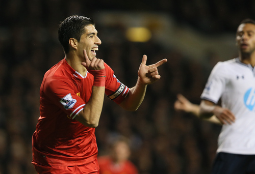 Liverpool's Luis Suarez celebrates after scoring a goal during the English Premier League soccer match between Tottenham Hotspur and Liverpool at the White Hart Lane stadium in London Sunday, Dec. 15, 2013. (AP Photo/Alastair Grant)