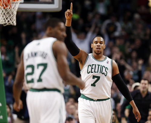 Boston Celtics' Jared Sullinger (7) celebrates his 3-pointer in front of teammate Jordan Crawford (27) in the fourth quarter of an NBA basketball game against the Minnesota Timberwolves in Boston, Monday, Dec. 16, 2013. The Celtics won 101-97. (AP Photo/Michael Dwyer)