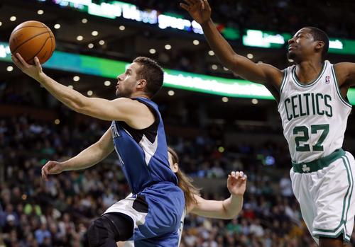 Minnesota Timberwolves' J.J. Barea, left, shoots in front of Boston Celtics' Jordan Crawford (27) in the first quarter of an NBA basketball game in Boston, Monday, Dec. 16, 2013. (AP Photo/Michael Dwyer)